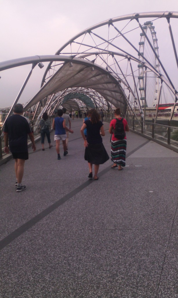 The Helix Bridge. Why build a normal bridge when you can make a cool looking one? That's me in the striped skirt.