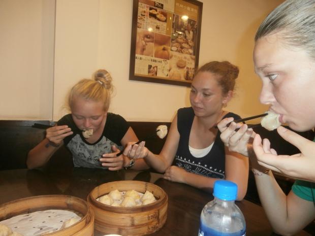 The girls enjoying Hangzhou's Xiao Long Bao