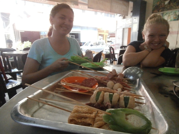 Sierra and Kali getting ready to enjoy Capitol Satay.