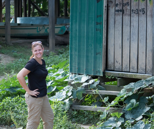 Standing in front of an outhouse in Borneo glamour shot