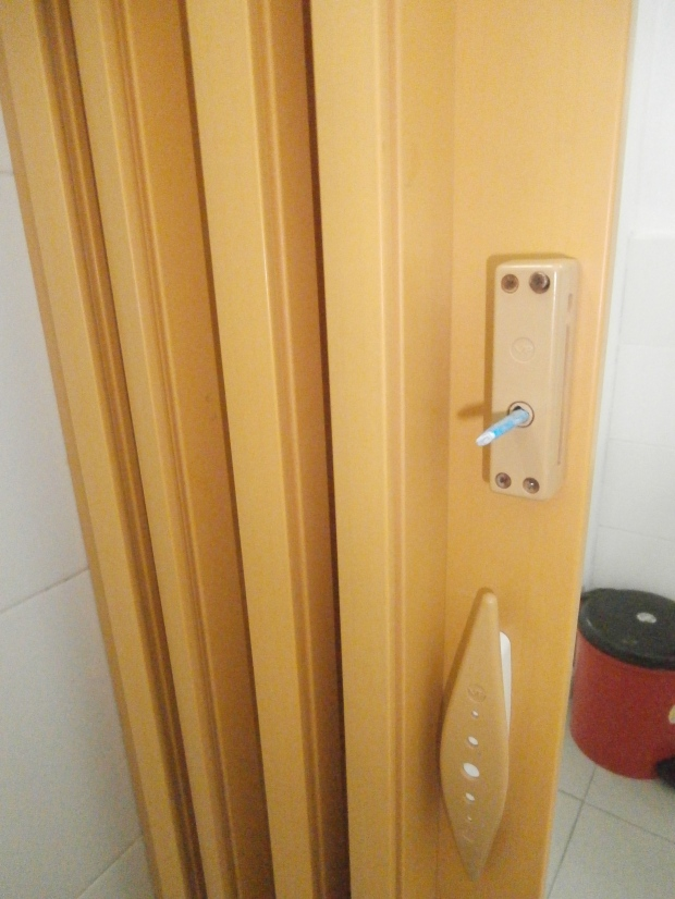 Bathroom door with rolled up paper fix