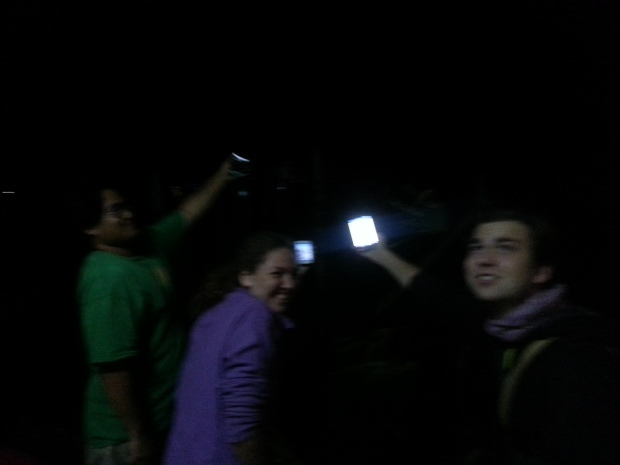 Holding their phones towards the hospital attempt to get a better wifi signal.